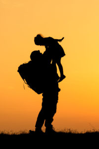 32813433 - silhouette of a soldier and a girl.